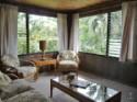 Aunty Lydia's Ohana - A comfy living room with garden & mountain views just a minute's walk to the beach.